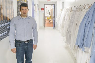 PhD candidate William Albabish stands in a hallway at the University of Guelph Human Anatomy lab.