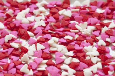 Cinnamon hearts in white, red, and pink scattered in a pile