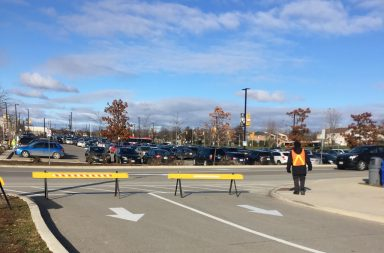 Security guards block driveway as parking lots become full