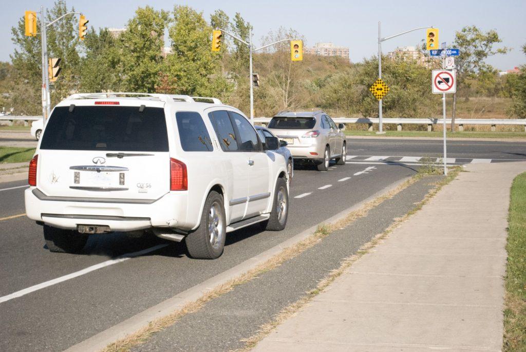 A white van blocking a bike lane