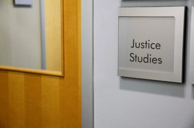 Picture of Justice Studies plaque outside Guelph-Humber office
