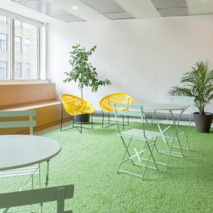 Astro-turf and lounge chairs inside a building.
