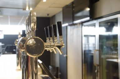 silver beer taps in a bar