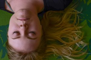 Calm looking woman lying on ground