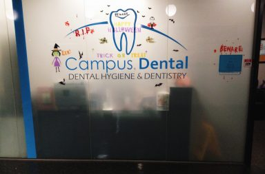 "The wall of the dental office that reads ""Campus Dental, Dental Hygiene and Dentistry"""