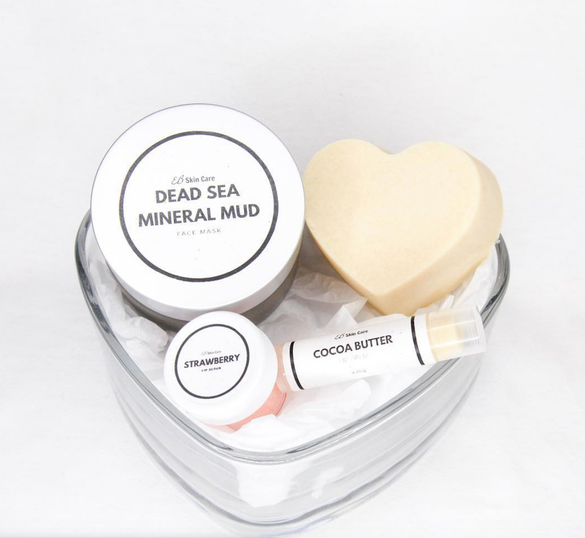 Sample of EB Skincare products, such as a face mask, lip balm, lip scrum and artisan soap.