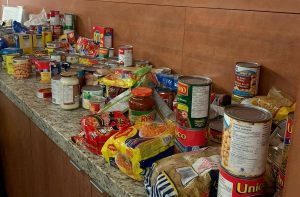 A group non-perishable food items on a counter top
