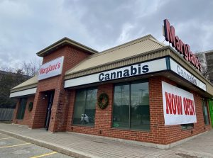 A brown brick building with signs that say Maryjane's Cannabis store